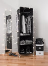 Clothes organizer and mirror decorated with lights Stock Photos