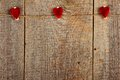 Clothes peg in shape of heart on old wooden background Stock Photo