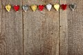 Clothes peg in shape of heart on old wooden background Royalty Free Stock Photography