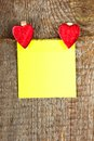 Clothes peg in shape of heart on old wooden background Stock Photos