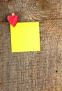 Clothes peg in shape of heart on old wooden background Royalty Free Stock Images