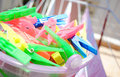 Clothes pegs in basked Royalty Free Stock Images