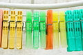Clothes pegs colorful on a line with water drops Royalty Free Stock Photography