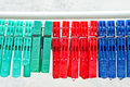 Clothes pegs colorful on a line with water drops Royalty Free Stock Photos
