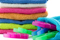 Clothes pegs with pile of towels colorful on background Stock Image
