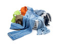 Clothes in plastic basket dropped isolated on white Royalty Free Stock Photo