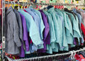 Clothes for sale on at market or shop Stock Images