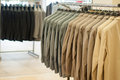 Clothes stands men jackets in a modern store Royalty Free Stock Photography