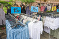 Clothes on the sunday market at Bomal Sur Ourthe. Royalty Free Stock Photo