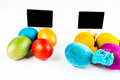 With and without clothes two groups of easter eggs Royalty Free Stock Photo