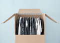 Clothes in a wardrobe box for easy moving Royalty Free Stock Photo