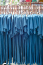 Clothes and wood coat hanger rows of Stock Photography