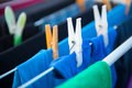 Clothesline with clothes and clothespin Stock Photography