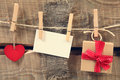 On a clothesline red hearts hanging with wooden background Stock Photography