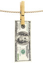 Clothespin dollar bill is hanging on a rope with wooden isolated on white Stock Image