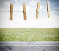 Clothespin on a laundry line outside above wooden boards Royalty Free Stock Photo