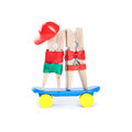 Clothespin skateboarders. Skating boy, girl on blue skate board. White background. Sport, love, friendship concept. Royalty Free Stock Photo
