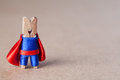 Clothespin superhero man against retro paper background copy space super hero in blue suit and red cape confident style soft focus Stock Image