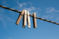 Clothespins on a line in a yard Royalty Free Stock Image