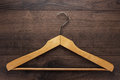 Clothing hanger on brown table Royalty Free Stock Photo