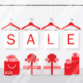 Clothing hangers SALE signage and banners behind shopping window Royalty Free Stock Photo