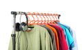 Clothing and headphones on the hanger, white background. Royalty Free Stock Photo