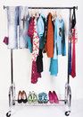 Clothing and shoes on the rack Royalty Free Stock Photo