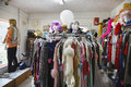 Clothing and wigs at second hand store view of in a crowded Royalty Free Stock Photos