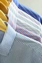 Cloths on wooden hangers Royalty Free Stock Photos
