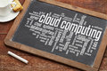 Cloud computing on blackboard word a vintage slate with a cup of coffee Stock Image
