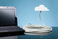 Cloud computing concept laptop connected to cloud via ethernet cable Royalty Free Stock Images