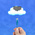 Cloud computing concept officeman hold cable connect to server with clouds blue sky background Stock Image