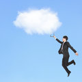 Cloud computing concept young business man holding touch pad and jump to clouds asian model Royalty Free Stock Photos