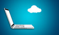 Cloud computing laptop technology connectivity concept on blue background Royalty Free Stock Photo