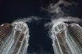 Cloud flew through the Twin Towers at night in Kuala Lumpur, Malaysia Royalty Free Stock Photo