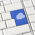 Cloud icon in blue on a white computer keyboard