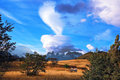 The cloud over patagonia amazing sunset illuminates mountains and fields with light wondrous Royalty Free Stock Image
