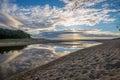 Cloud reflections on coastal lagoon Royalty Free Stock Photo