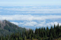 Cloud sea over mountain top Stock Photos