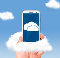 Cloud technologies male hand is holding modern smartphone in skies Royalty Free Stock Photos