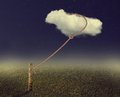 Cloud tied to the column Royalty Free Stock Photo
