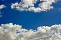 Clouds in afternoon in summer at a bright sunlight Stock Photography
