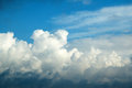 Clouds in a blue sky dramatic white float deep Stock Photos