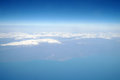 Clouds and blue sky seen from plane Stock Photography
