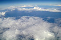 Clouds and blue sky seen from plane Stock Image