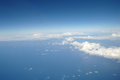 Clouds and blue sky seen from plane Royalty Free Stock Photo