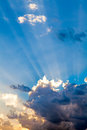 Clouds In The Blue Sky and Sun Rays Royalty Free Stock Photo