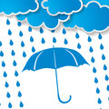 Clouds with  blue umbrella and rain drops Royalty Free Stock Photo