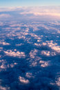 Clouds bright morning dawn in the sky top view night and day the setting sun sunset light illuminates the upper cloud layers Stock Photos