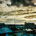 Clouds on the city storm in evening time with antennas roofs of Royalty Free Stock Photo